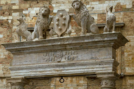 archway: Stone lions, archway, Montepulciano, Italy. Stock Photo