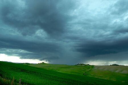 Oncoming storm in countryside of Tuscany region of Italy.