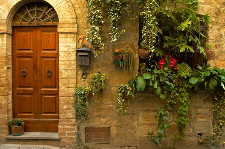 Walls and flowers in villages in Tuscany region of Italy. Stock Photo