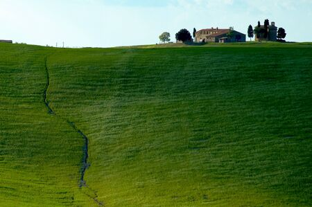 Farmhouse in Tuscany region of Italy. 免版税图像