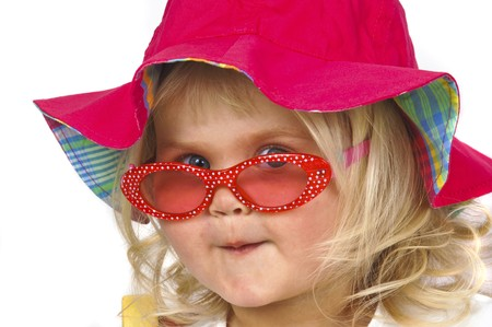 babes: Blond baby girl in red hat and sunglasses Stock Photo