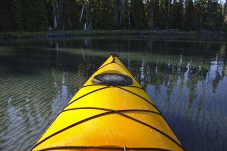 prow: Prow of a yellow kayak.