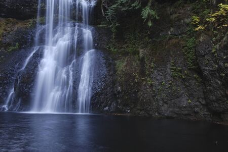oregon cascades: Long exposure of waterfall, blurred into white.