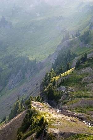 Tents perched on the edge of a precipice on a mountain. photo