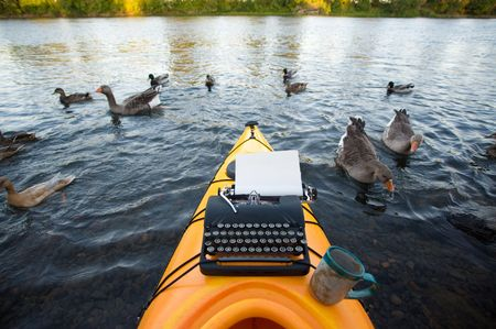 Kayak with a typewriter and a coffee cup on it. photo