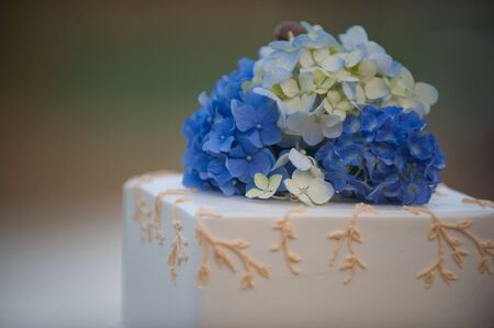 Blue and white flowers on a wedding cake