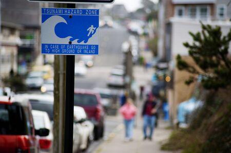 Tsunami warning sign in an urban zone. photo