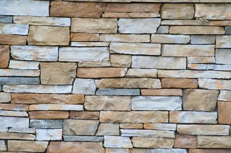 Een muur van zandsteen bleke bakstenen, goed voor een textuur. Stockfoto - 4575019