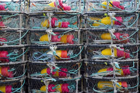buoys: Stack of crab traps and colorful buoys. Stock Photo