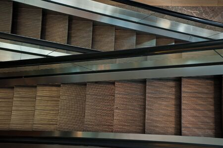 Narrow up and down escalators placed nexted to each other