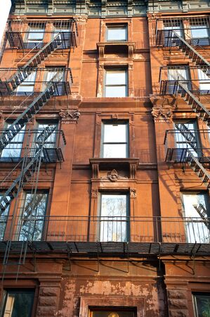building material: Old brick apartment buildings in a big city. Stock Photo