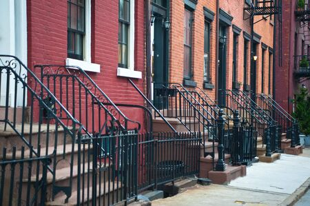 Stairways leading to doors of a row of old apartments. Stock Photo