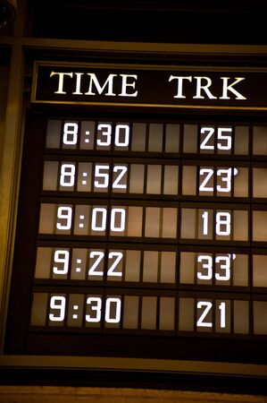 Display of departure times and tracks for trains. Stock fotó