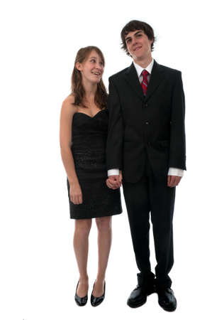 frock coat: Young couple dressed up in formal wear for prom night date.