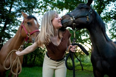 horse blonde: Woman kissing a horse Stock Photo