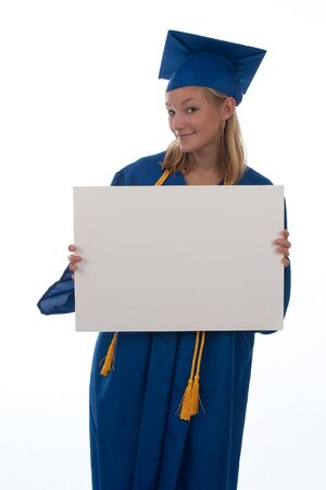 Teen girl in graduation gown holding an blank sign Stock Photo
