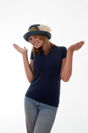 Cheerful teenage blond girl in a hat 写真素材