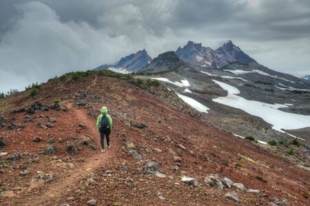 oregon cascades: Person hiking near Broken Top Mountain, Oregon