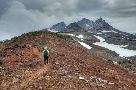 mountain top: Person hiking near Broken Top Mountain, Oregon