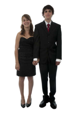 Young couple dressed up in formal wear for prom night date. photo