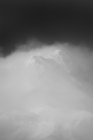 Clouds hovering around a snowy mountain peak, Mt. Hood photo