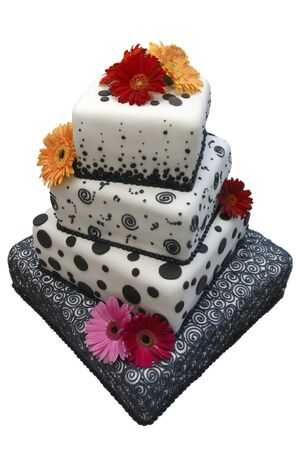 Ornate multi-tiered wedding cake with black polka-dots