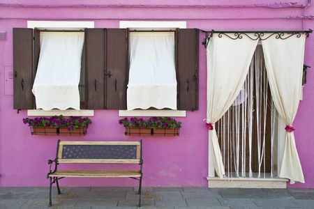 awnings: Colorful walls and windows in Burano Italy Editorial