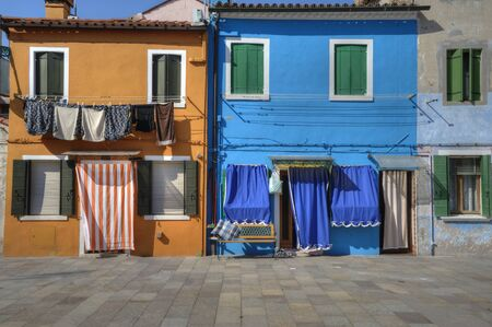 awnings: Colorful walls and windows in Burano Italy Stock Photo