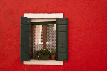 Colorful windows and flowerpots in Burano Italy Stock Photo - 12993159
