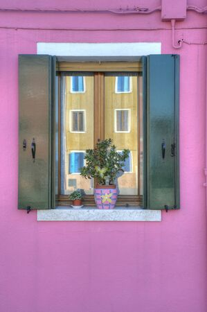 burano: Colorful windows and flowerpots in Burano Italy