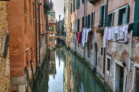 Laundry drying above a canal in Venice, Italy Stock Photo - 12988650