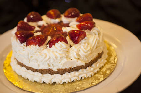 Whipped cream cake with strawberries on top Stock Photo - 13387859
