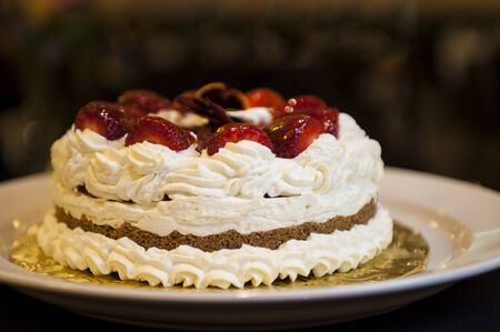 Whipped cream cake with strawberries on top Banco de Imagens