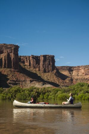 Mother and daughter paddling a canoe on Green River, Utah Stock Photo - 13533806
