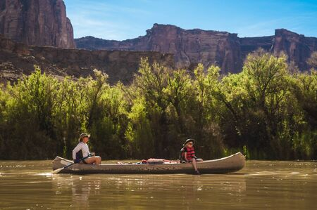 Mother and daughter paddling a canoe on Green River, Utah photo