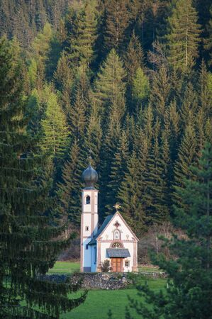 Small church surrounded by trees in Tyrol region of Italy