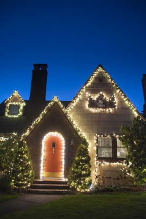 holiday display: Suburban house decorated with lights for Christmas