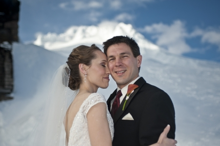 Bride and groom in winter snow on mountain Stock Photo - 17265025
