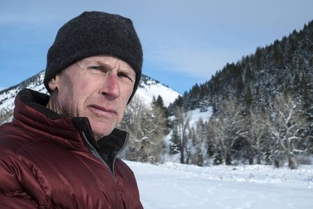 Mature adult man in snowy landscape