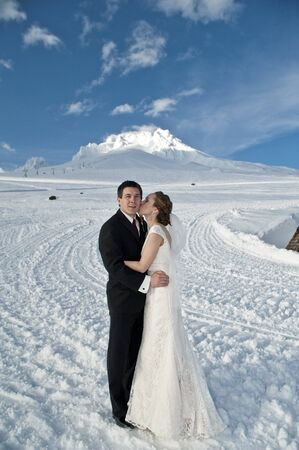 Bride and groom in winter snow on mountain Stock Photo - 17265054