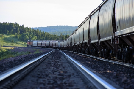 freight train: Freight train with hopper cars beneath mountains