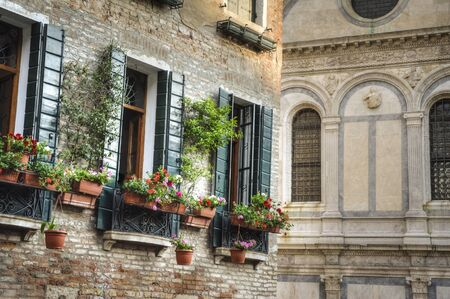europeans: Flower boxes below a window in Venice, Italy Stock Photo