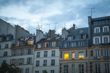 Paris apartments at twilight, one light on Stock Photo - 18240341