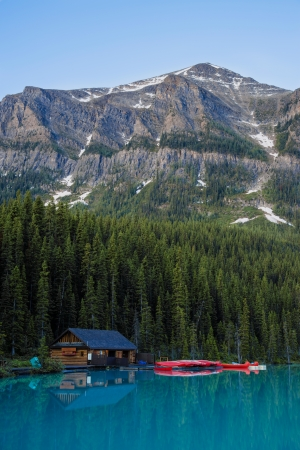 Boathouse and red canoes, Banff National Park, Canada Stock Photo