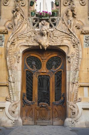 entranceway: Old ornate wooden doors in Paris, France