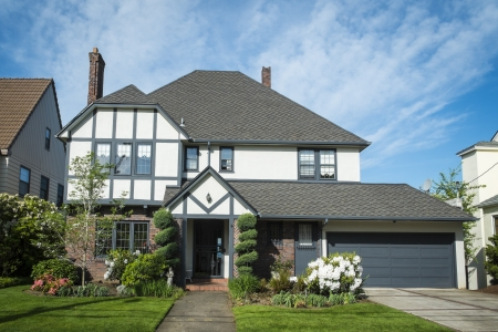 suburban: Classic American suburban house with blue sky background Editorial