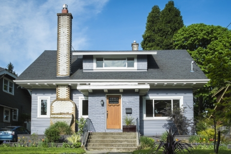 Single-family American craftsman house with blue sky background Stock Photo - 19326249