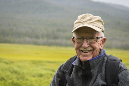 Happy active senior man enjoying the outdoors
