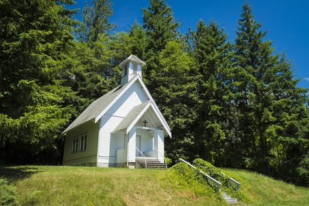 Old small rural church with steeple in Oregon photo