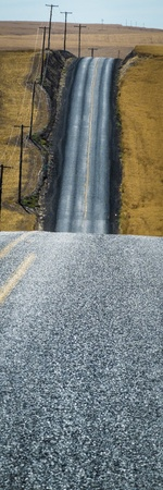 Road through wheat fields ready for harvest in Washington State photo